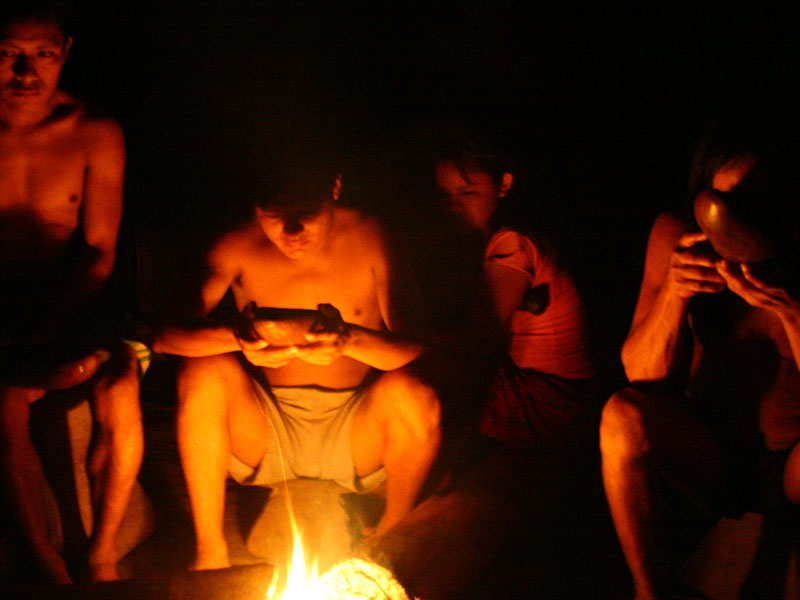 A Family sits around the fire